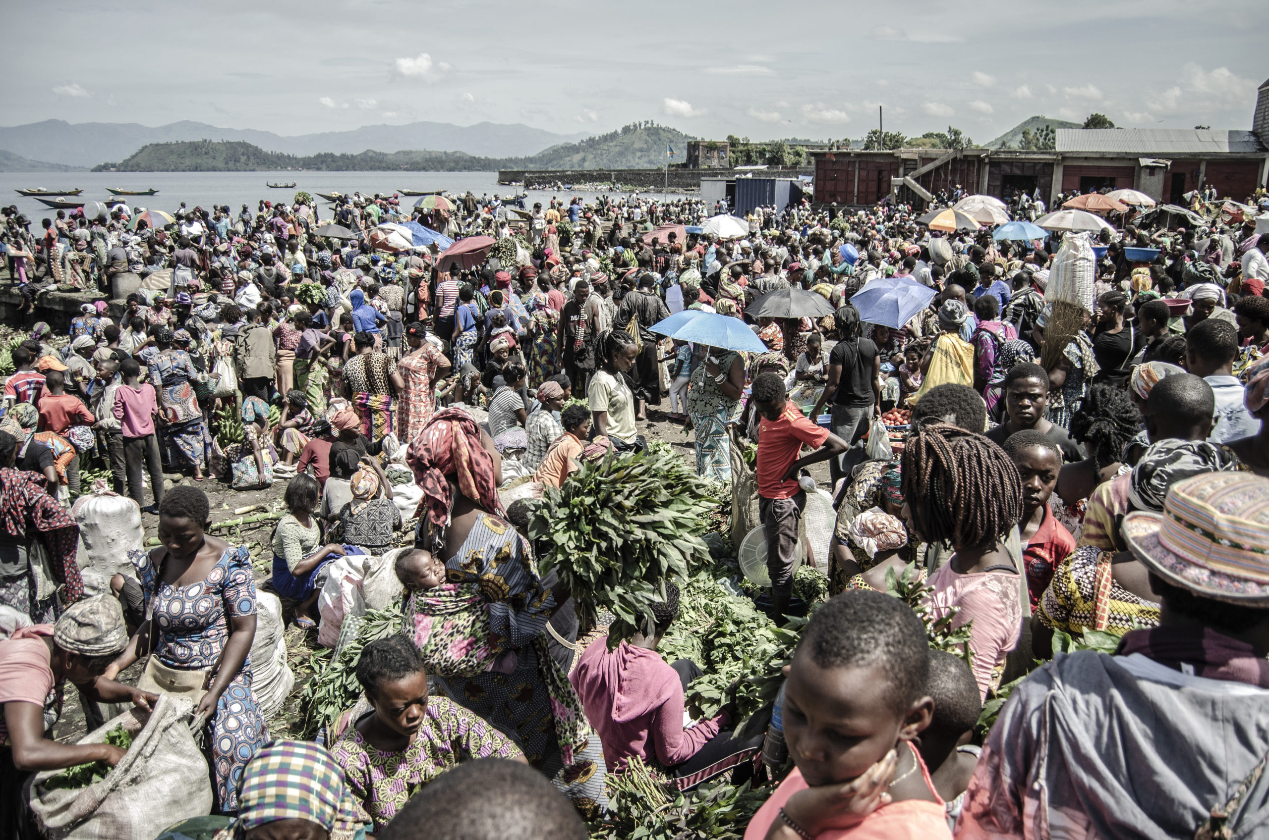 Vendors and shoppers at a market on the shores of Lake Kivu in Goma, eastern Democratic Republic of Congo, April 2, 2020. Many Congolese survive on their daily earnings and cannot afford to follow health advisories on maintaining social distance. Moses Sawasawa/Fondation Carmignac